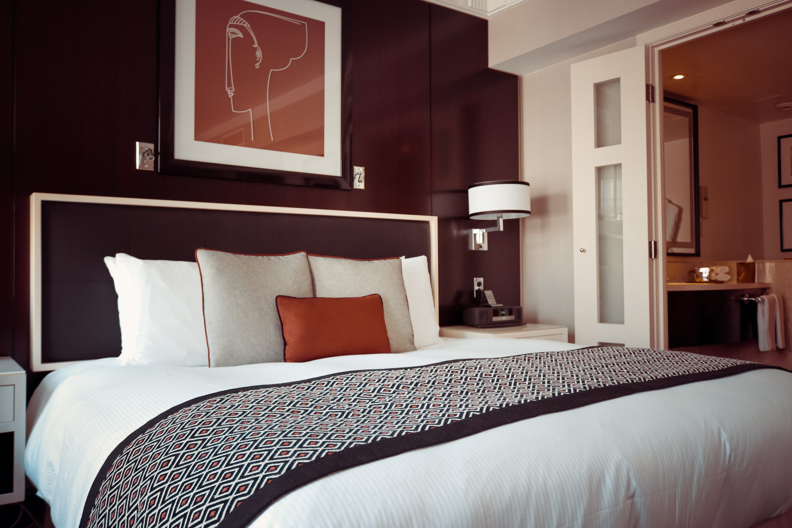 black-and-grey-bedspread-on-bed-and-pillow-164595